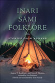 Photo of a tent at night with the Northern Lights above. The tent glows softly from the campfire within.