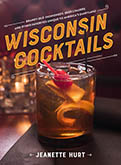 Wisconsin Cocktails: Cover art showing a brandy old fashioned, including a cherry and orange rind, sitting atop of table. The background of the image is heavily blurred, matching the warm tones of the cocktail. The title text is proclaimed in bold orange text at a slight angle, with delicate white lines above and below it.