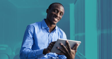 Kenyan man with tablet