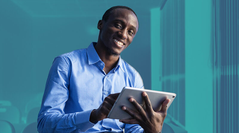 Kenyan man with tablet